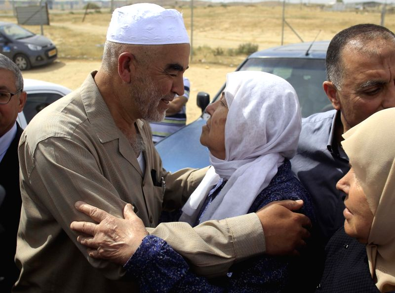 JERUSALEM, May 8, 2016 - Arab-Israeli Sheikh Raed Salah (L), the leader of the northern wing of the Islamic Movement in Israel, bids farewell to his mother Laqia as he arrives at the Eshel prison in ...