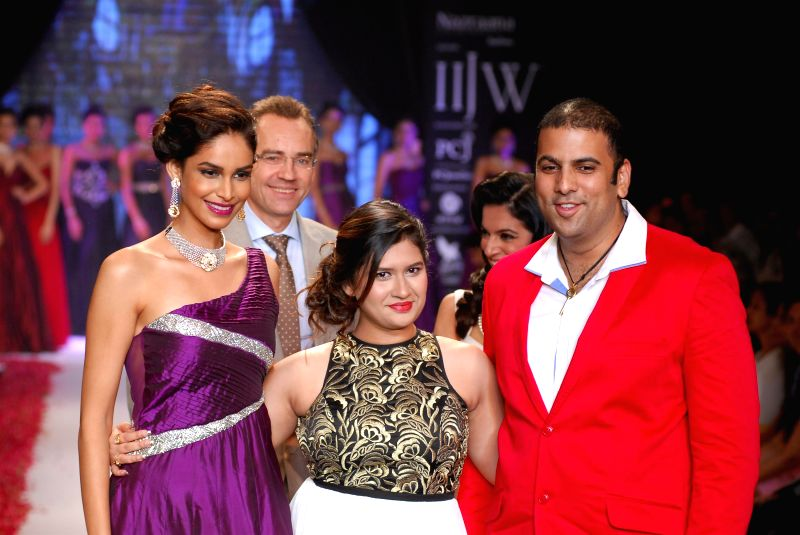 Jewellery designer Manali Jagtap and Saurabh Gadgil, CEO and MD P N Gadgil Jewellers during the India International Jewellery Week (IIJW) in Mumbai, on July 15, 2014.