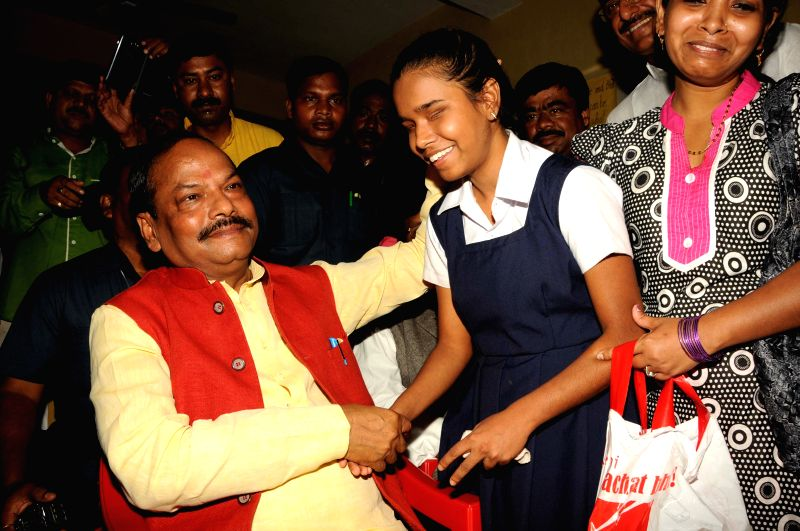 Jharkhand Chief Minister Rabghubar Das meets with 17 year old Tumpa Kumari, the visually challenged singer from Ranchi on July 9, 2015. The seventeen-year-old Tumpa Kumari, is a student at ... - Rabghubar Das