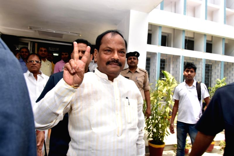 Jharkhand Chief Minister Raghubar Das flashes victory sign after GST bill was passed in the state assembly during in Ranchi on April 27, 2017. - Raghubar Das