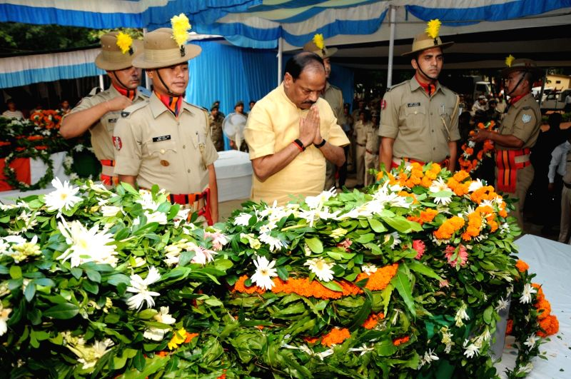 Jharkhand Chief Minister Raghubar Das pays tribute to the CRPF trooper and Jharkhand policeman who were killed in during a shootout with Maoists in Khuti district; in Ranchi on June 7, 2018. - Raghubar Das