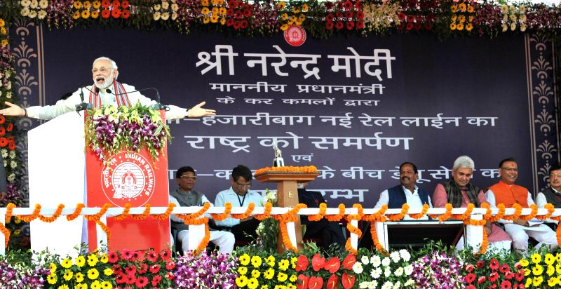 Prime Minister Narendra Modi addresses during the inauguration of the New Railway Line between Hazaribag and Kodarma, in Jharkhand on Feb 20, 2015. Also seen Union Minister for Railways ... - Narendra Modi
