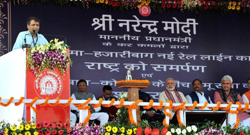 Union Minister for Railways Suresh Prabhakar Prabhu addresses during the inauguration of the New Railway Line between Hazaribag and Kodarma, in Jharkhand on Feb 20, 2015. Also seen Prime ... - Narendra Modi