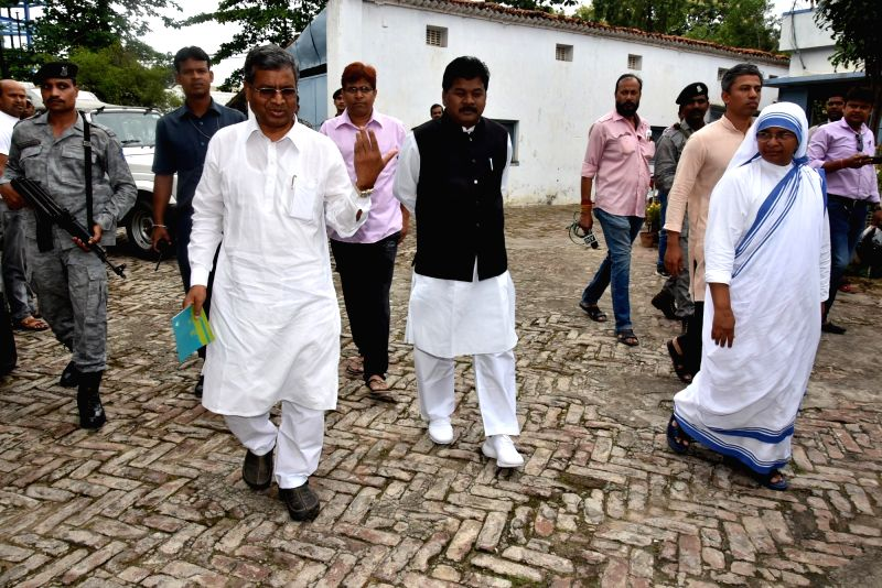 Jharkhand Vikas Morcha leaders Babulal Marandi and Bandhu Tirkey during their visit to the Missionaries of Charity, which is facing charges of selling newborns to childless couples; in Ranchi ...