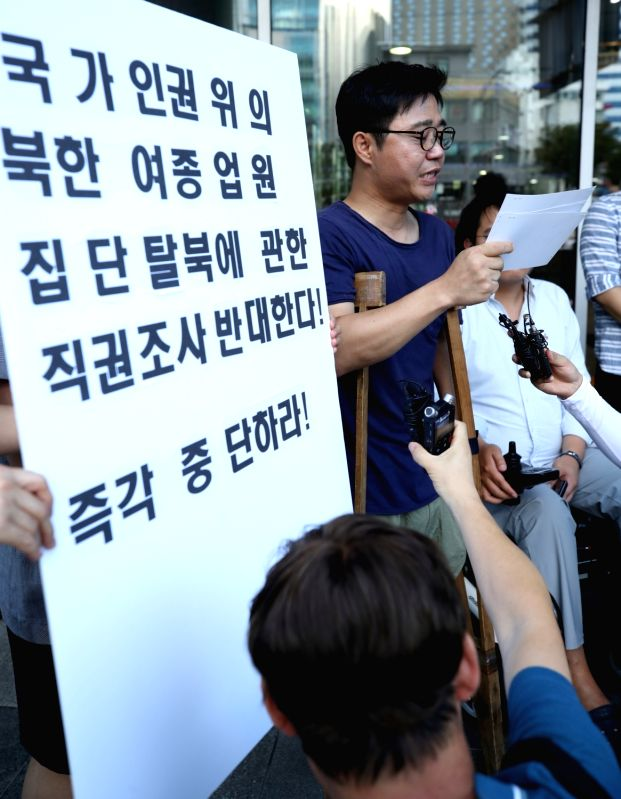 Ji Seong-ho, a North Korean defector who lost a leg and a hand in North Korea before defecting to South Korea, stages a rally in front of the National Human Rights Commission of Korea in ...