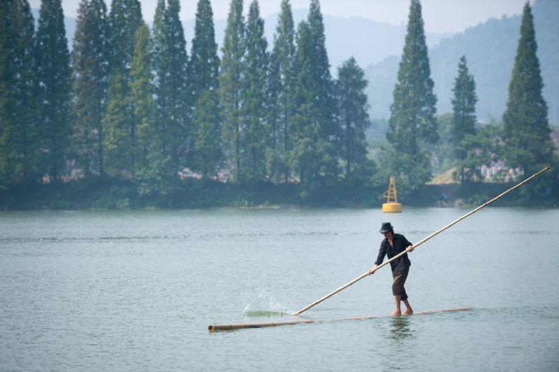 JIANDE, July 26, 2017 - Fang Shuyun, 52, a native of Hangzhou City, crosses Xin'an River using two bamboo poles in Meicheng Town, Jiande, Hangzhou, east China's Zhejiang Province, July 26, 2017. Fang ...