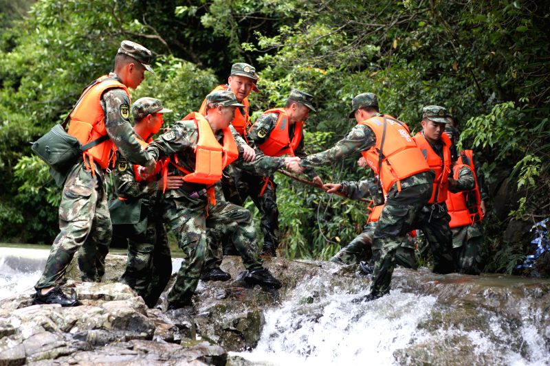 JIANGMEN, May 29, 2016 - Soldiers search for the missing tourists at the accident site at Fenghuangxia scenic area in Jiangmen City, south China's Guangdong Province, May 29, 2016. Eight tourists ...