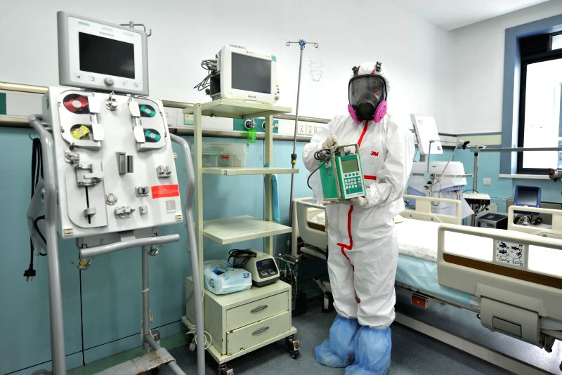 A staff attends a medical drill in a negative-pressure isolation ward which can be used to accommodate Ebola virus disease (EVD) patients at Shandong Provincial ...