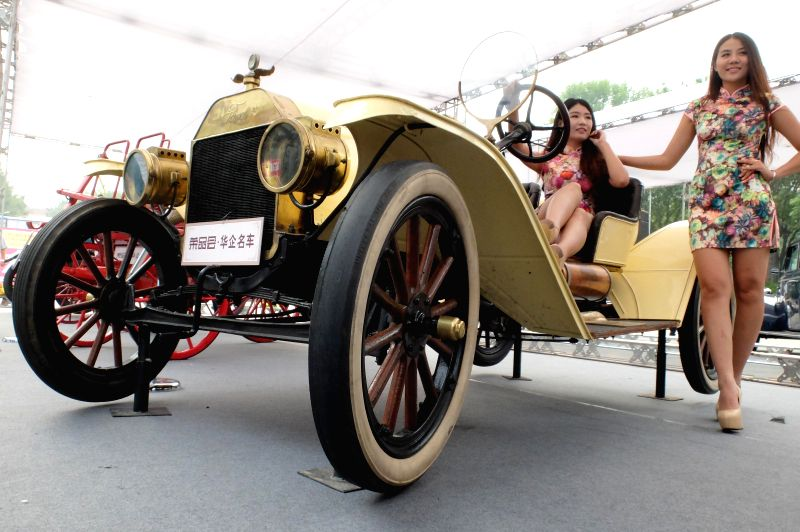 A Ford Model-T antique car is displayed during an exhibiton of American classic antique cars in Jinan, capital of east China's Shandong Province, Aug. 30, 2014.  ...