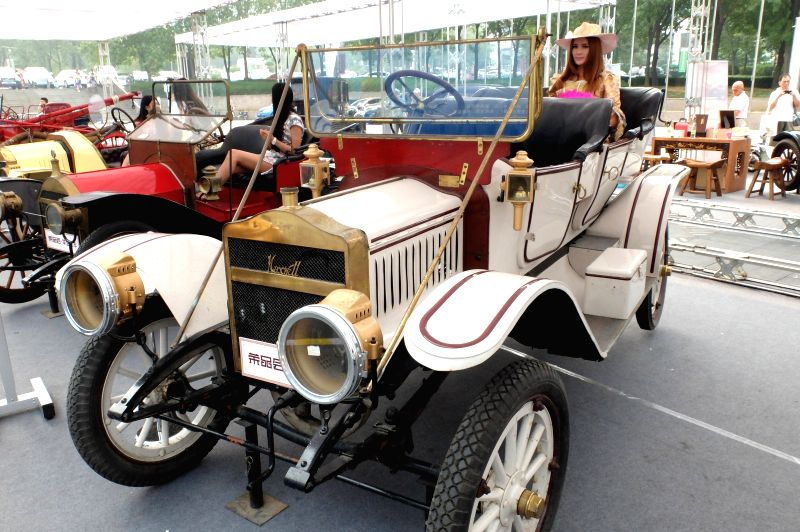 A Maxwell antique car is displayed during an exhibiton of American classic antique cars in Jinan, capital of east China's Shandong Province, Aug. 30, 2014.  ...