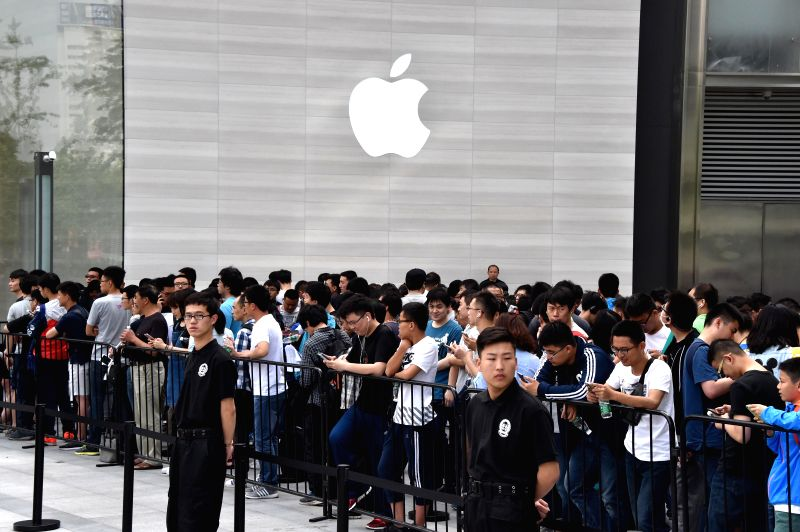 JINAN, May 21, 2016 - People line up to enter an Apple retail store in Jinan, east China's Shandong Province, May 21, 2016. The first Apple retail store in Jinan opened on Saturday.