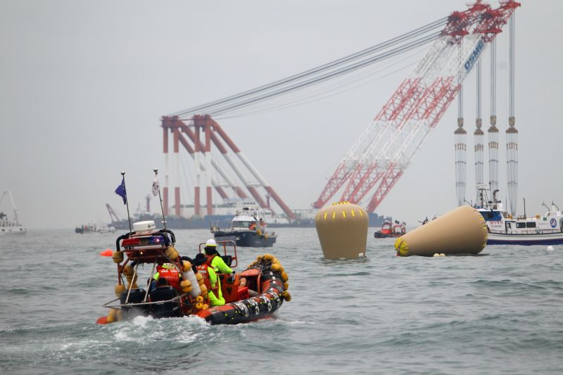 Air bags can be seen near the capsized ferry in Jindo on April 18, 2014. South Korean coast guard and navy divers will seek to enter into the hull of the sunken ...