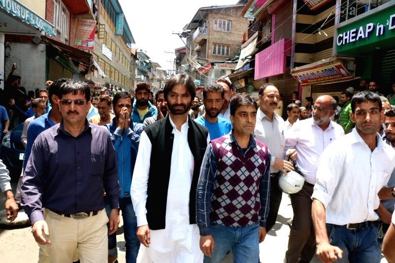 JKLF chairman Mohammad Yasin Malik leads a rally organised to protest against killing of two militants in Srinagar on May 25, 2016. - Malik