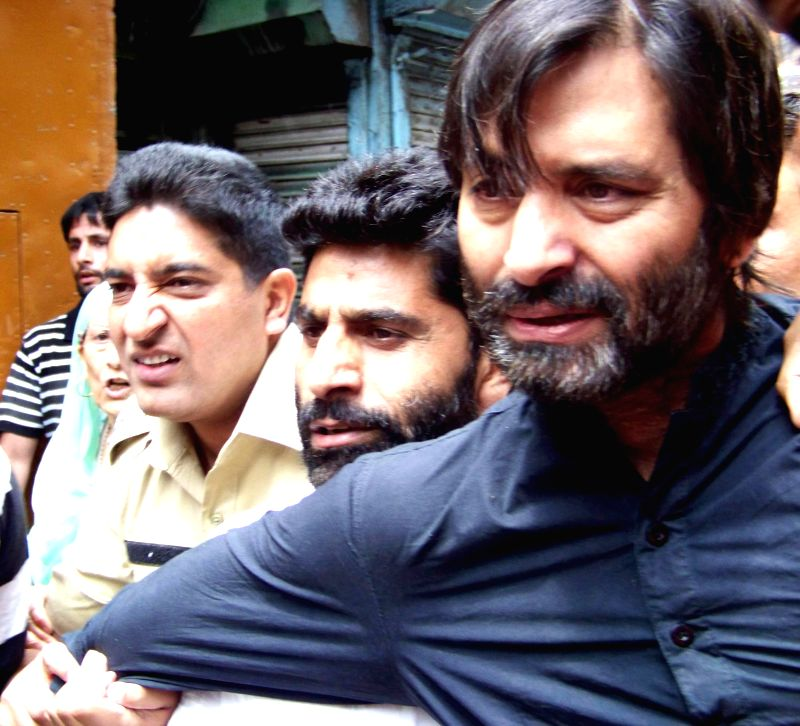 JKLF chairman Mohammad Yasin Malik who had called for 'Lal Chowk Challo' rally to start his 'Quit Kashmir' movement being arrested in Srinagar on June 23, 2014.