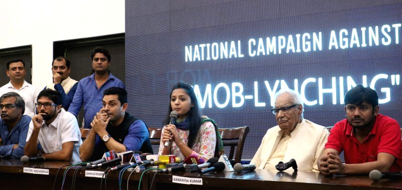 JNU student leader Kanhaiya Kumar addresses during a programme organised to launch National Campaign against Mob-lynching in New Delhi, on June 5, 2017. Also seen JNU student leader Shehla ... - Kanhaiya Kumar
