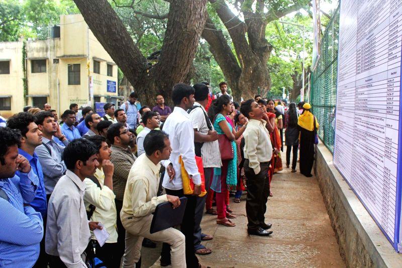 Job aspirants visit a job fair. (File Photo: IANS)
