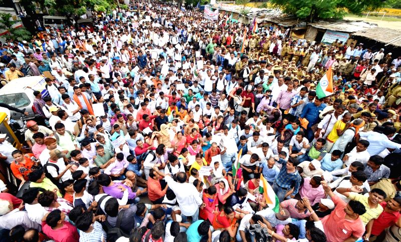 Job aspirants who have cleared TET exam stage a demonstration to press for their demands in Patna on July 23, 2018.