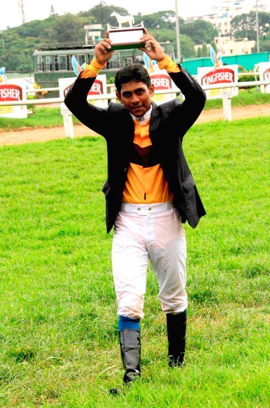 Jockey Suraj Narredu after winning Kingfisher Derby 2014 at Bangalore Turf Club in Bangalore on July 13, 2014.
