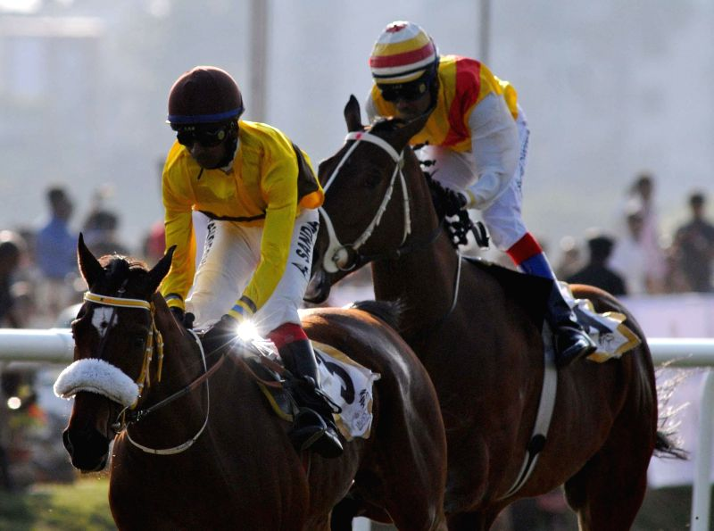 Jockeys in action during  Legacy Bangalore Winter Derby 2015 in Bengaluru, on Jan 26, 2015.