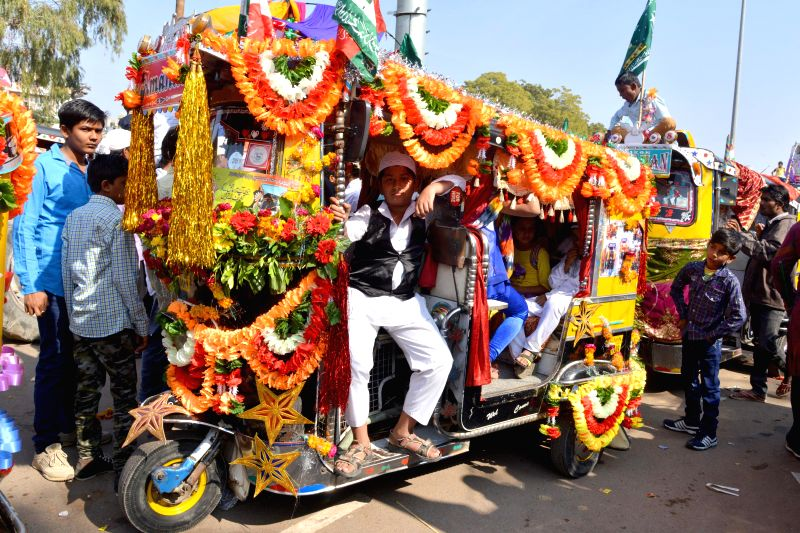 A decorated auto-rickshaw participates in a procession organised on  Eid Milad-un-Nabi - Prophet Mohammad's birthday in Jodhpur, on Jan 4, 2015.