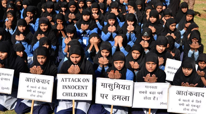 Children participate in a silent protest against Tuesday's attack on the Army Public School in Peshawar, Pakistan, that claimed 104 lives mostly those of children, in Jodhpur, on Dec 17, ...