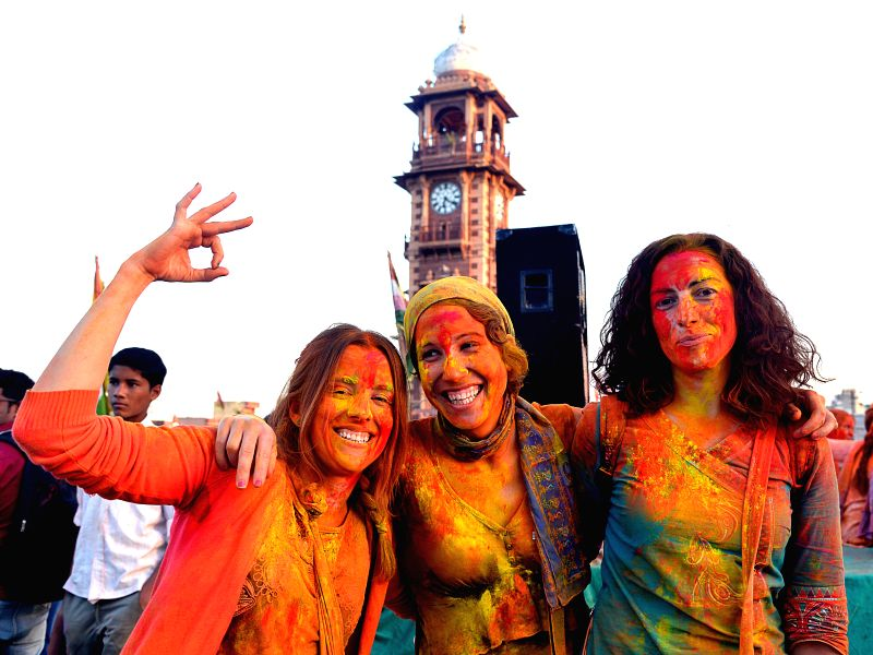Foreign tourists celebrate Holi at Clock Tower in Jodhpur on March 4, 2015.