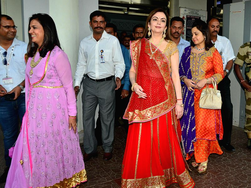 Founder and chairperson of the Dhirubhai Ambani International Nita Ambani with her daughter arrives at Jodhpur on Nov 29, 2014.