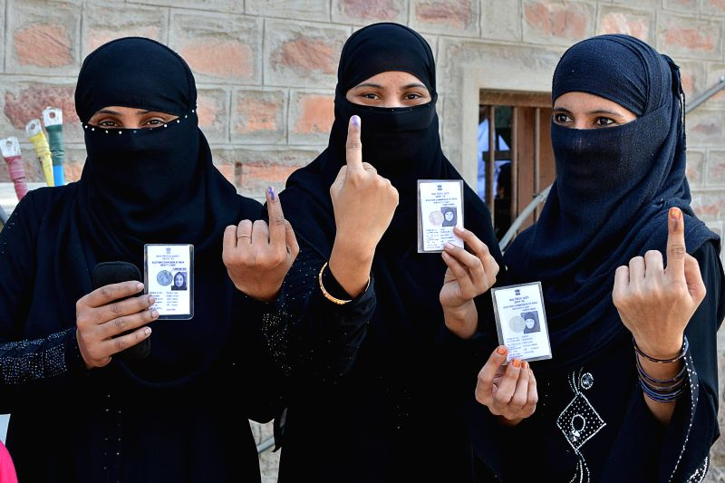 Muslim women shows her fore finger marked with phosphorous ink after casting her vote at a polling booth for Municipal election in Jodhpur, Rajasthan, on Nov 22, 2014.