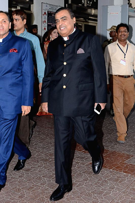 Reliance Industries Ltd (RIL) Chairman Mukesh Ambani arrives in Jodhpur to attend a wedding ceremony on Nov 29, 2014.