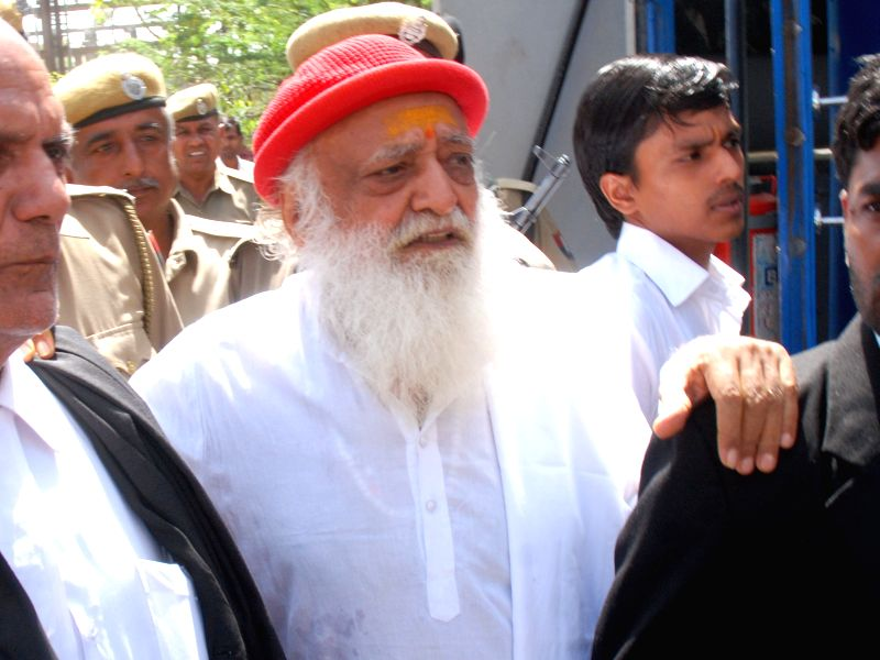 Self-styled 'godman' Asaram Bapu being taken to be produced before a Jodhpur court in connection with an alleged sexual assault on a minor; on April 29, 2015.