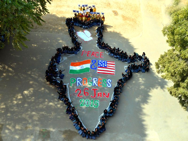 Jodhpur : Students create map of India with flags of USA and India in Jodhpur on Jan. 24, 2015.