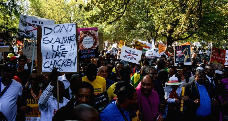 People holding anti-xenophobia placards take part in the People's March Against Xenophobia in Johannesburg Town, South Africa, on Apr. 23, 2015. Thousands of ...