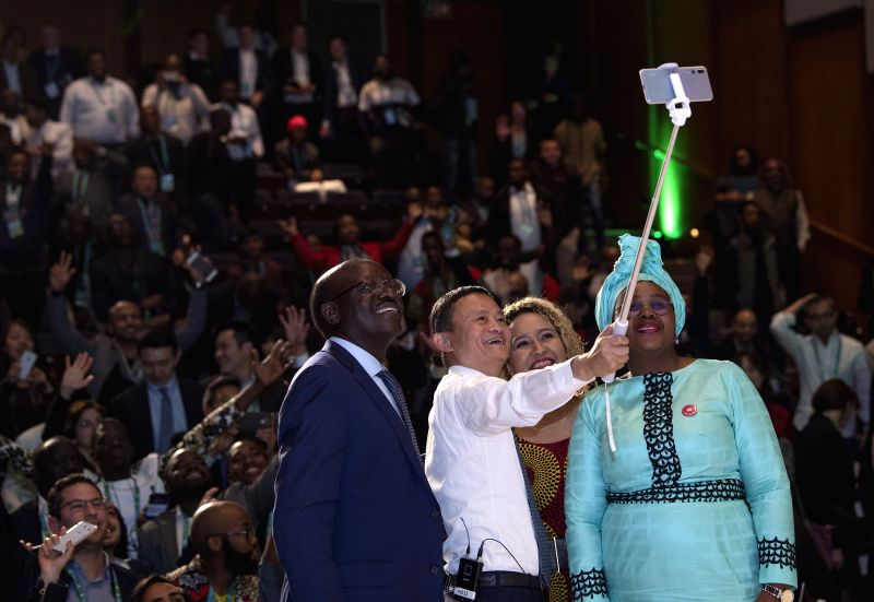 "JOHANNESBURG, Aug. 9, 2018 - Chinese Alibaba's Chairman Ma Yun (2nd L) takes a selfie with honor guests during the conference ""The Rise of Africa's Digital Lions"" in Johannesburg, South ..."