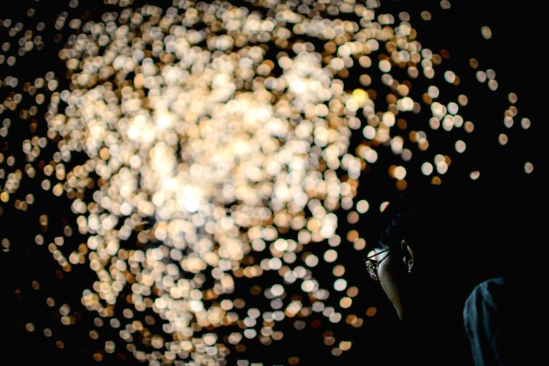 JOHANNESBURG, Jan. 29, 2017 - A woman watches fireworks in Johannesburg, South Africa, on Jan. 28, 2017. The Chinese community in South Africa held a fireworks show in Johannesburg on Saturday to ...
