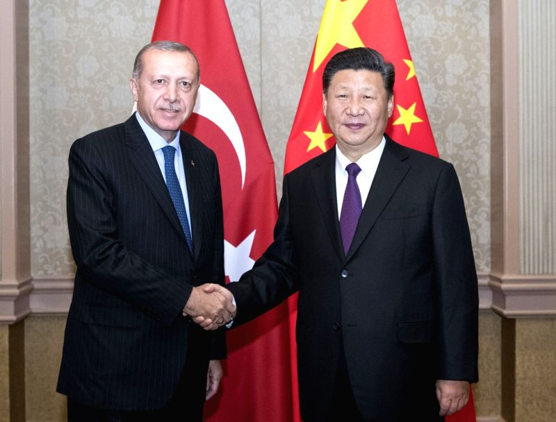 JOHANNESBURG, July 26, 2018 - Chinese President Xi Jinping (R) meets with his Turkish counterpart Recep Tayyip Erdogan in Johannesburg, South Africa, July 26, 2018.