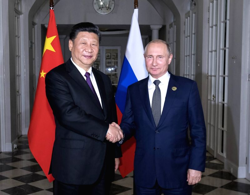 JOHANNESBURG, July 26, 2018 - Chinese President Xi Jinping (L) and his Russian counterpart Vladimir Putin hold a meeting and also have dinner together in Johannesburg, South Africa, July 26, 2018.