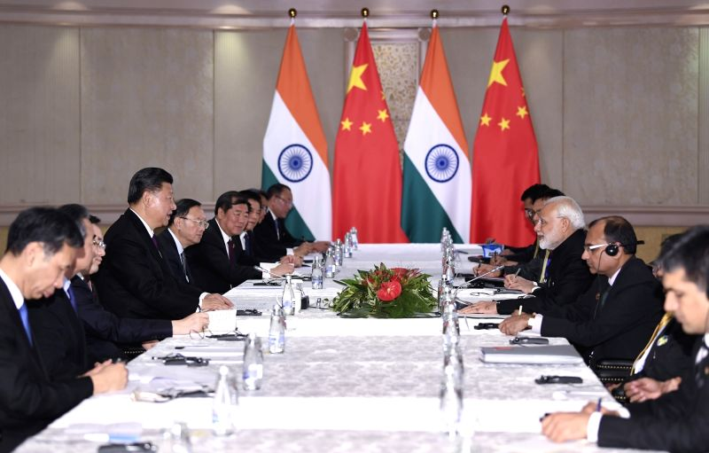JOHANNESBURG, July 26, 2018 - Chinese President Xi Jinping meets with Indian Prime Minister Narendra Modi in Johannesburg, South Africa, July 26, 2018. - Narendra Modi