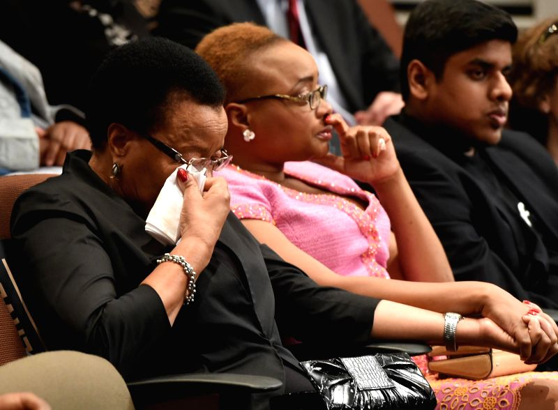 Johannesburg (South Africa): Graca Machel (L), widow of late former South Africa's President Nelson Mandela, attends the opening ceremony of the Nelson Mandela Condolence Books Exhibition at the ...