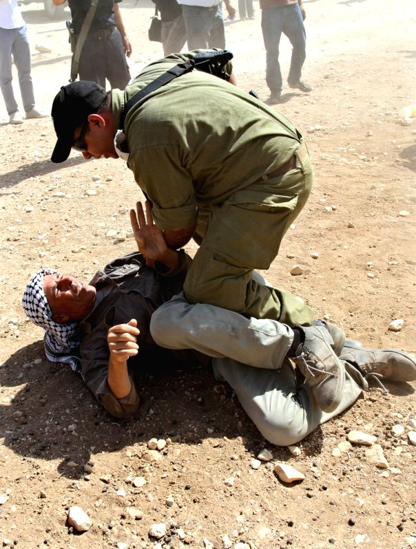 Israeli soldier attacks a Palestinian Bedouin