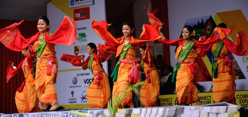 Artists perform during a cultural programme organised on the inaugural day of Assam International Trade and Industrial Fair (AITIF) in Jorhat, on Feb 19, 2015.
