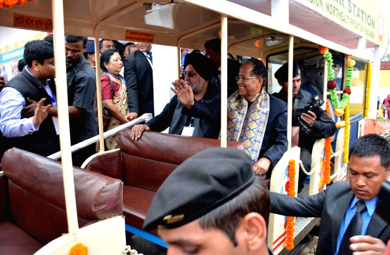 Assam Chief Minister Tarun Gogoi rides a toy train on the inaugural day of Assam International Trade and Industrial Fair (AITIF) in Jorhat, Assam on Feb 19, 2015. - Tarun Gogoi