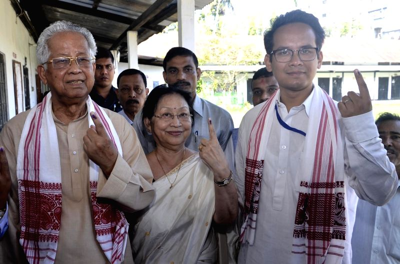 Jorhat: Former Assam Chief Minister Tarun Gogoi, wife Dolly Gogoi with son and Congress' Lok Sabha candidate from Kaliabor, Gaurav Gogoi shows their inked finger after casting vote for Lok Sabha election at a polling station, in Assam's Jorhat, on Ap