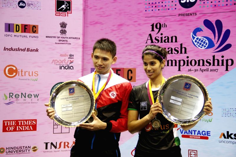 Joshna Chinappa of India and Max Lee (L) of Hong Kong pose the winner of 19th Asian Squash Championships women's singles and men's singles respectively, during the presentation ceremony in ...
