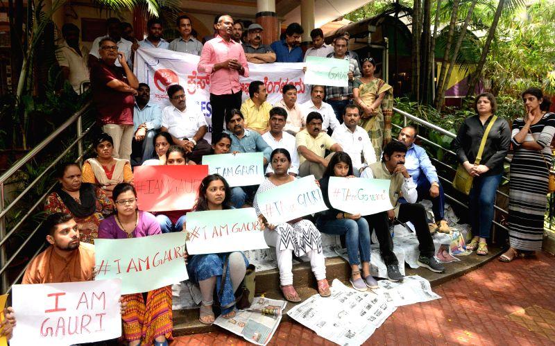 "Journalists protest against the killing of Bengalaru journalist-turned-activist Gauri Lankesh in Bengaluru on Sept 6, 2017. Editor of the weekly Kannada tabloid ""Lankesh ..."