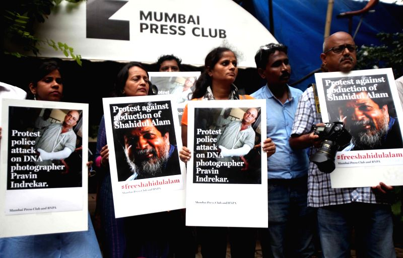 Journalists stage a demonstration against attack on Bangladesh journalist Shahidul Alam as well as assault of photographer Pravin Indrekar during a police crackdown on illegal alcohol sale in ...