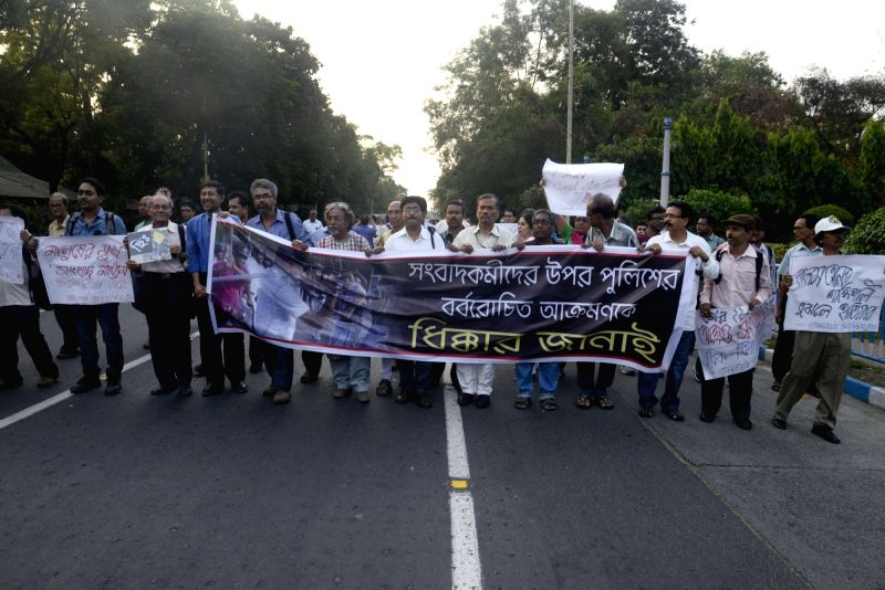 Journalists stage a demonstration against May 22 police attack on fellow journalists in Kolkata, on May 22, 2017.