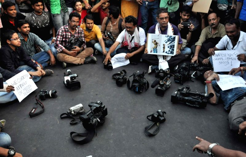 Journalists stage a demonstration against police attack on their fellows in Kolkata, on May 23, 2017.