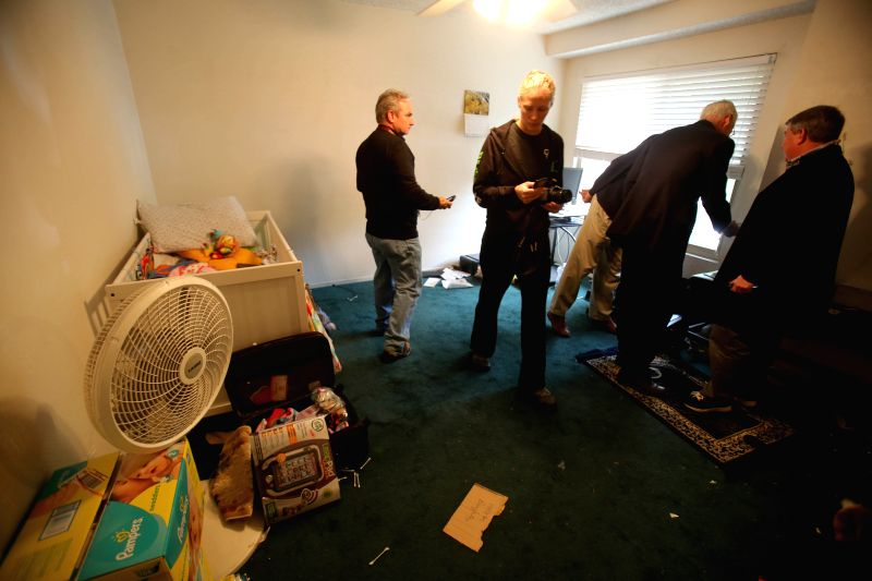 Journalists visit the residence of shooting suspect Syed Farook in San Bernardino, California, Dec. 4, 2015. The FBI is investigating the deadly Southern ...