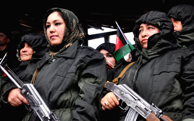 Afghan policewomen attend a gathering in which local residents announce their support for the Afghan government in Jowzjan province in northern Afghanistan, Jan. 5, .
