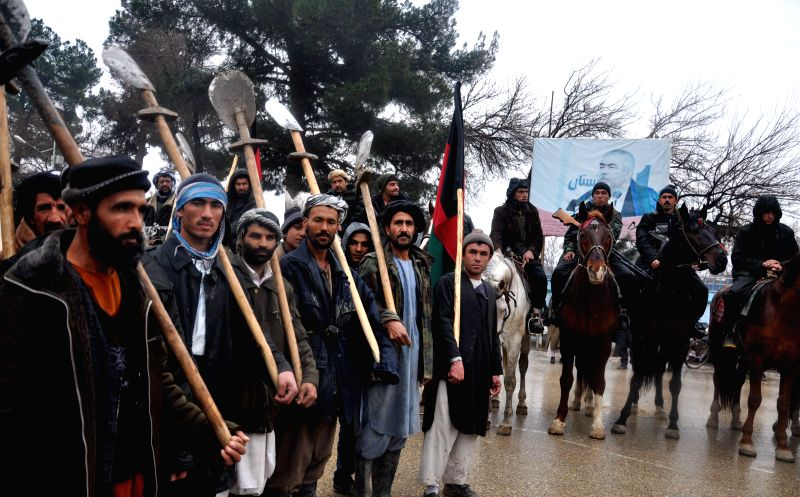 Local residents announce their support for the Afghan government in Jowzjan province in northern Afghanistan, Jan. 5, 2015. Thousands of Afghan people including ...